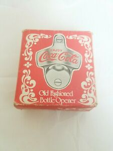 COCA COLA OLD FASHIONED BOTTLE OPENER W/DAMAGED BOX. MISSING THE SCREWS.