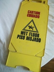 Caution Wet Floor Sign English Spanish 25 Inches Tall Yellow Continental