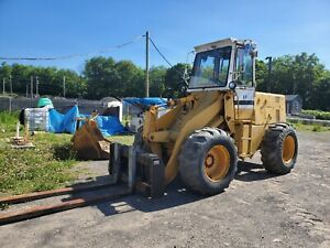 Ih Wheel Loader With 8 Forks And Bucket video