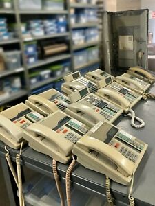 Meridian Norstar Telephone System With 11 Off white Phones
