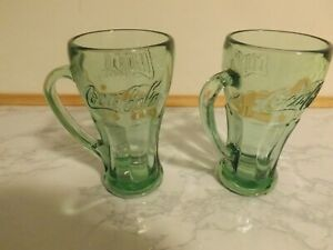 2 Vintage Green Coca Cola mugs.  Heavy glass. Excellent Condition