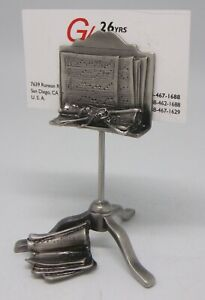 Business Card Holder Music Stand With Music Score On Easel Lyre On Rear