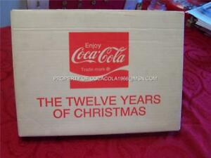 COCA COLA COKE 12 YEARS OF CHRISTMAS FRAMED BOX PIN SET