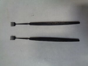 V Mueller Ebonized Four Prong Skin Hooks Rakes