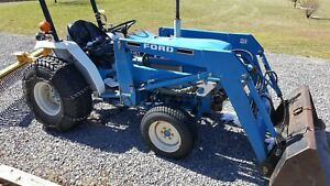 diesel Tractor 1994 Ford 1520 with Front Bucket And 2 mower ph 301 712 8601