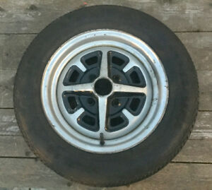 Used Mg 14 Rostyle True Steel Wheel Rim With Douglas Xtra trac Tire P185 65r14