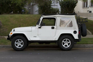 97 06 Jeep Tj Wrangler 51124 52 Replace A Top Soft Top In Stone White Denim