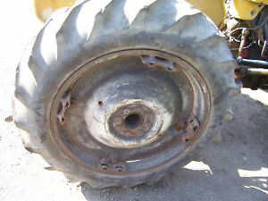 Vintage Ford 871 Tractor power Adjust 28 Rear Rims Tires