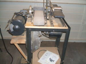 3 ELECTRIC BENCH TOP TOOLS ON A STAND - GRINDER  DISCBELT SANDER  JOINTER .
