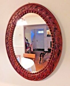 Oval Wall Mirror In Antique Heavy Medium Tone Wood Frame With Lots Of Detailing