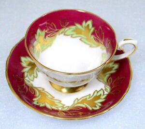 A Beautiful Green Golden Leaves Red Background Tuscan England Cup Saucer Set