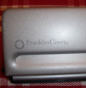 Franklin Covey Four sheet Seven hole Punch For Classic Style Day Planner Pages
