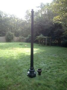 Antique Cast Iron Lamp Post With Raised Rounded Sides And Ornate Base