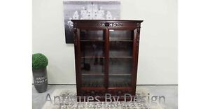Circa 1890 Victorian Mahogany Northwind Carved Two Door Bookcase With Drawers