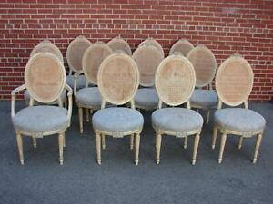 Set Of 12 Painted French Style Cane Chairs