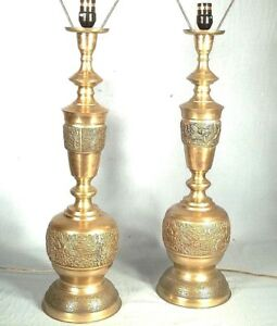 Pair Of Mid Century Modern James Mont Asian Figural Embossed Brass Lamps
