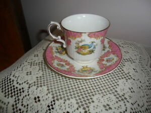 Queen S Rosina Tea Cup And Saucer Set Pink And Gold With Colorful Bird Design