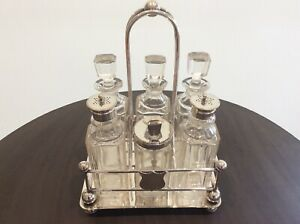 Vintage Silver Plate Six Bottle With Caddy Condiment Set