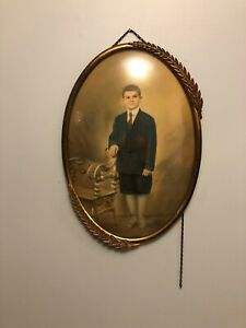 Vintage Metal Convex Frame With A Picture Of A Young Handsome Boy