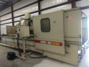 Used Komo 40 240 Cnc Vertical Machining Center Mill Fanuc 18i m 10k Rpm 4th 1998