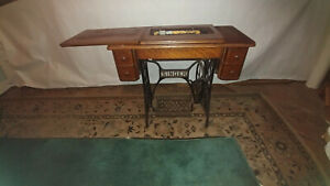 Antique Treadle Singer Sewing Machine In Cabinet