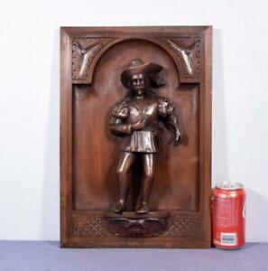French Antique Carved Panel In Walnut Wood With A Parisian Man With A Sword