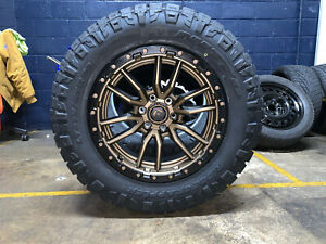 20x9 Fuel D681 Rebel Bronze Wheels 34 Nitto Tires 8x170 Ford Excursion
