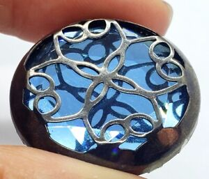 Vintage Button Unusual Faceted Blue Mirror Background With Metal Design On Top