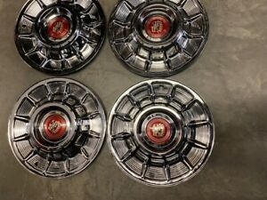 1957 Cadillac Hubcaps With Medallions