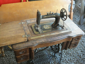 1917 New Home Treadle Sewing Machine W Extra Attachments New Belt Bobbin Papers