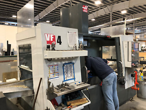 Used 2014 Haas Vf 4 Cnc Vertical Machining Center Mill 4th Axis Ready Chip Auger