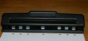 Acco Adjustable 7 hole Punch