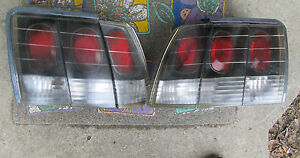 Styleline Lot Fits 1999 2004 Ford Mustang Tail Lights For Parts As Is Broken