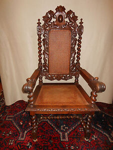 French Renaissance Heavily Hand Carved Oak Arm Chair With Original Caning