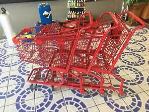 3 Small Red Shopping Carts And 12 Green And Blue Shopping Baskets With Stand