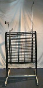 Store Display Fixtures Garment Rack 4 Adjustable Arms And Grid Area