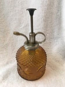 Yellow Floral Perfume Or Oil Bottle With Clear Bottle Also