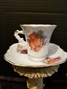 Vintage Hand Painted Miniature Cup And Saucer
