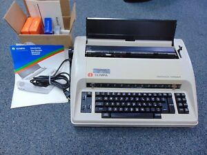 Olympia Electronic Compact Typewriter Includes Booklet Ribbon Lift off Tape