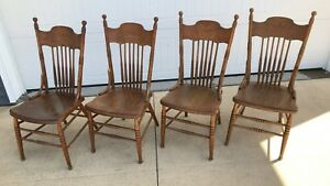Matching Set Of Four Antique Pressed Back Chairs With Solid Wooden Seats
