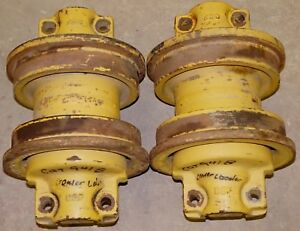 Two Caterpillar Crawler Track Rollers
