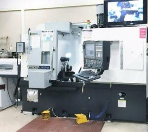 Okuma Genos L300 mwy Lathe Mill Turn W bar Feed At A Tremendous Value