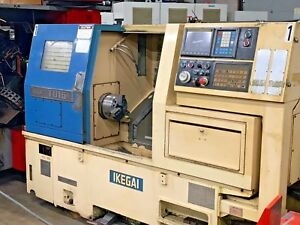 Cnc Turning Center W Fanuc O t Control 8 Chuck Turret 12 Prog Tailstock