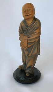 Wood Carving Of A Japanese Figure