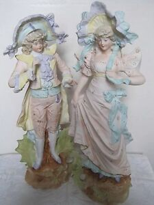 A Pair Of Antique Rudolstadt Bisque Figurines A Man And Woman In Court Dress