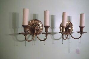 Pair Of Antique Bronze Wall Sconces With Classical Design Motifs