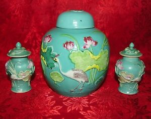 Three Chinese Green Crane And Lotus Jars With Covers And Applique