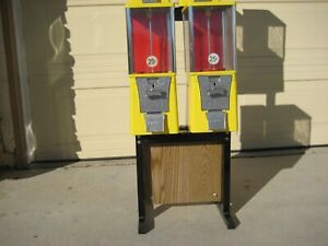 Four Yellow Eagle oak Vista Candy toy gumball Machines On Frame Stand