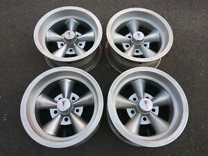 4 Vintage Torq Thrust Style 14x7 Aluminum Wheels With Pontiac Center Caps