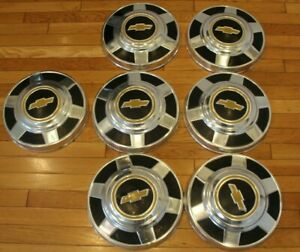 Set Of 7 Vintage Chevy Gold Bowtie Hubcaps